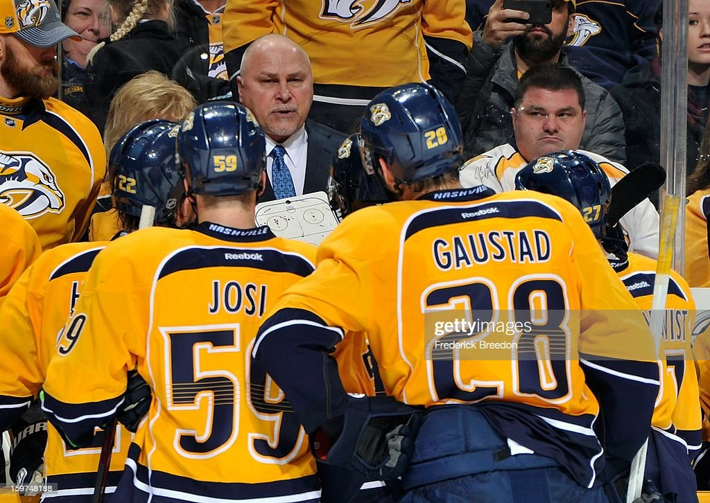 Head coach <a gi-track='captionPersonalityLinkClicked' href=/galleries/search?phrase=Barry+Trotz&family=editorial&specificpeople=212800 ng-click='$event.stopPropagation()'>Barry Trotz</a> of the Nashville Predators and assistant coaches <a gi-track='captionPersonalityLinkClicked' href=/galleries/search?phrase=Roman+Josi&family=editorial&specificpeople=4247871 ng-click='$event.stopPropagation()'>Roman Josi</a> #59 and <a gi-track='captionPersonalityLinkClicked' href=/galleries/search?phrase=Paul+Gaustad&family=editorial&specificpeople=577980 ng-click='$event.stopPropagation()'>Paul Gaustad</a> #28 talk with the team during the season opener against the Columbus Blue Jackets at Bridgestone Arena on January 19, 2013 in Nashville, Tennessee.