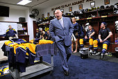 Head coach Barry Trotz of the Nashville Predators congratulates the team in the locker room after the series clinching win against the Detroit Red...