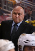 Head coach Barry Trotz of the Nashville Predators watches from the bench during the NHL game against the Phoenix Coyotes at Jobingcom Arena on...