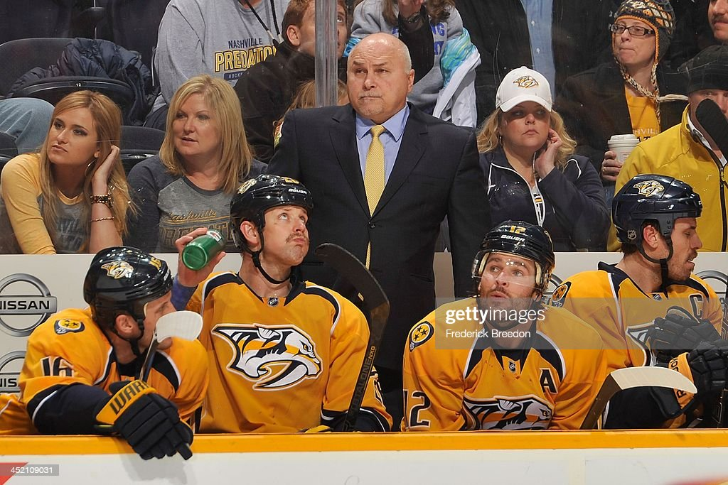 Head coach <a gi-track='captionPersonalityLinkClicked' href=/galleries/search?phrase=Barry+Trotz&family=editorial&specificpeople=212800 ng-click='$event.stopPropagation()'>Barry Trotz</a> of the Nashville Predators watches his team play against the Phoenix Coyotes at Bridgestone Arena on November 25, 2013 in Nashville, Tennessee.