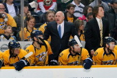Head coach Barry Trotz of the Nashville Predators yells toward officials during a game against the Minnesota Wild at Bridgestone Arena on March 9...