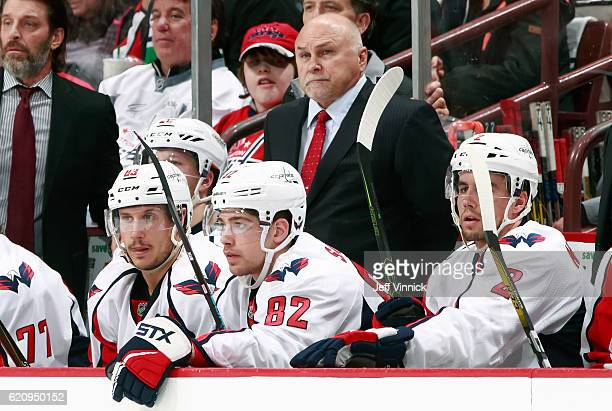 Head coach Barry Trotz of the Washington Capitals looks on from the bench during their NHL game against the Vancouver Canucks at Rogers Arena October...