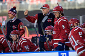 Head Coach Barry Trotz of the Washington Capitals looks on next to Alex Ovechkin during the first period of the 2015 NHL Winter Classic against the...