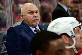 Head Coach Barry Trotz of the Washington Capitals watches from behind the bench in the first period of a game against the Montreal Canadiens during...