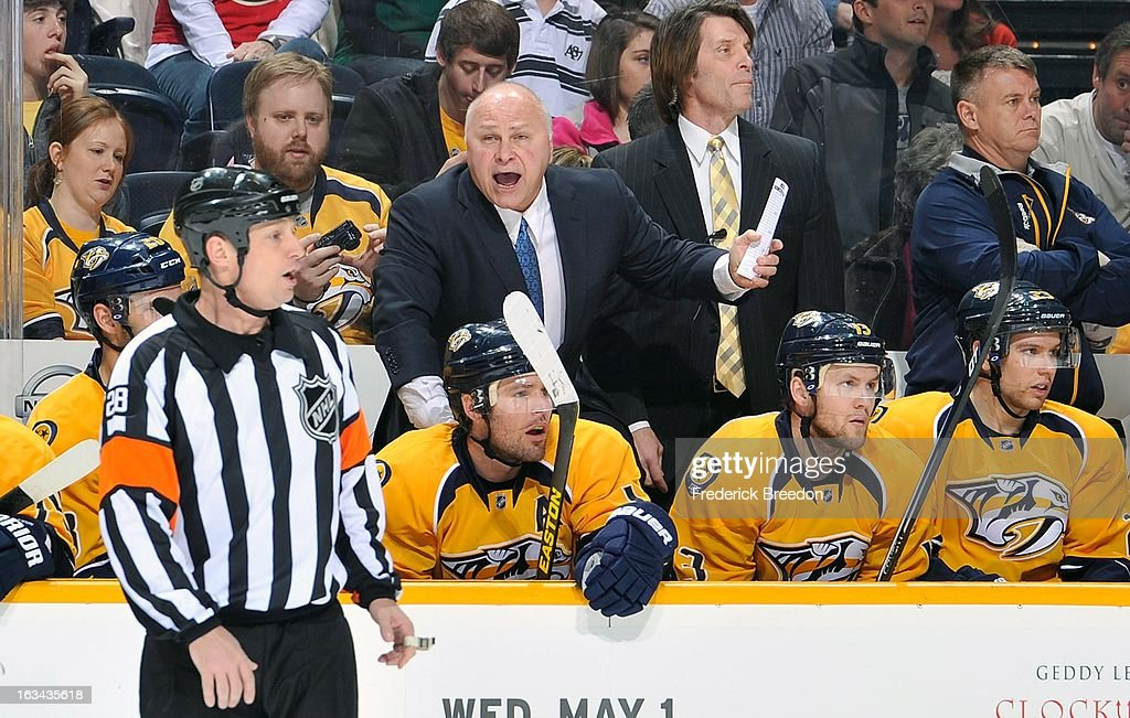 Head coach <a gi-track='captionPersonalityLinkClicked' href=/galleries/search?phrase=Barry+Trotz&family=editorial&specificpeople=212800 ng-click='$event.stopPropagation()'>Barry Trotz</a> tries to get the attention of referee Chris Lee #28 during a game against the Minnesota Wild at Bridgestone Arena on March 9, 2013 in Nashville, Tennessee.