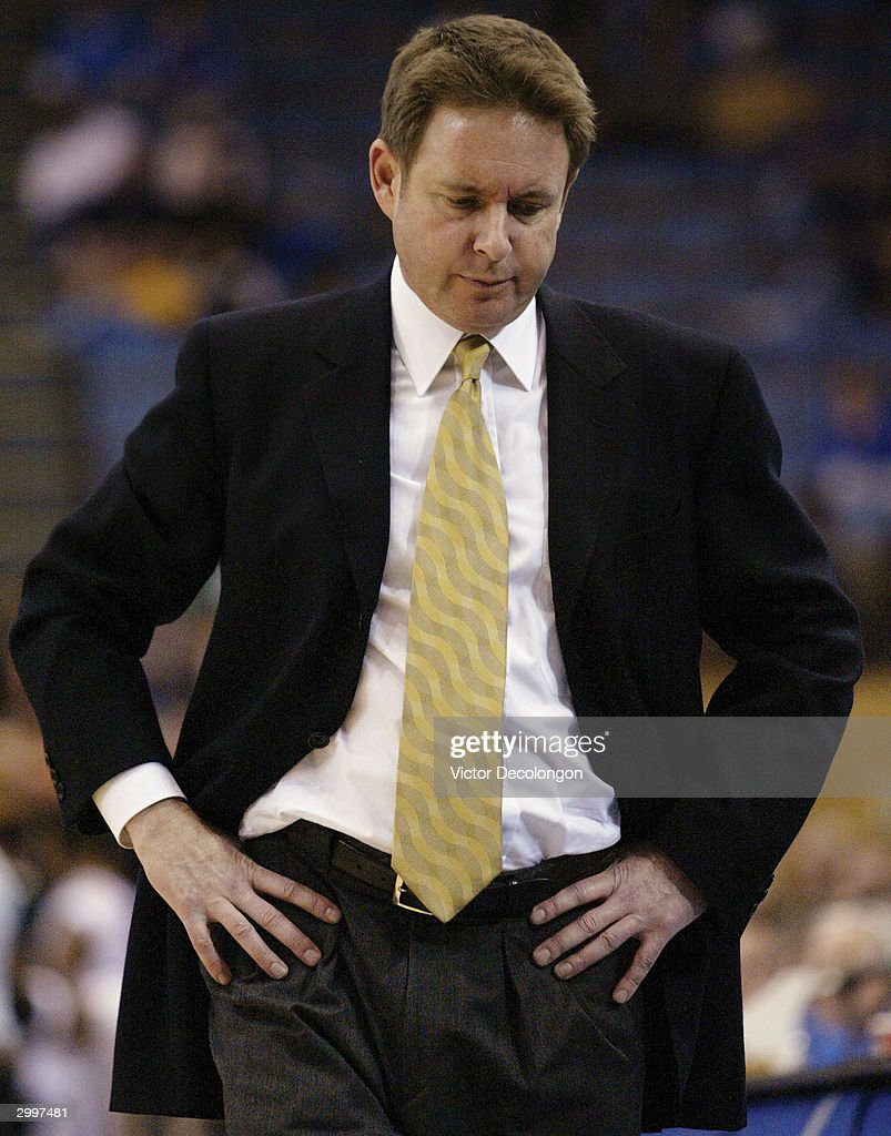Head Coach Ben Braun of the California Bears looks on dejectedly en route to a 6649 loss to the UCLA Bruins on February 19 2004 at Pauley Pavilion in...