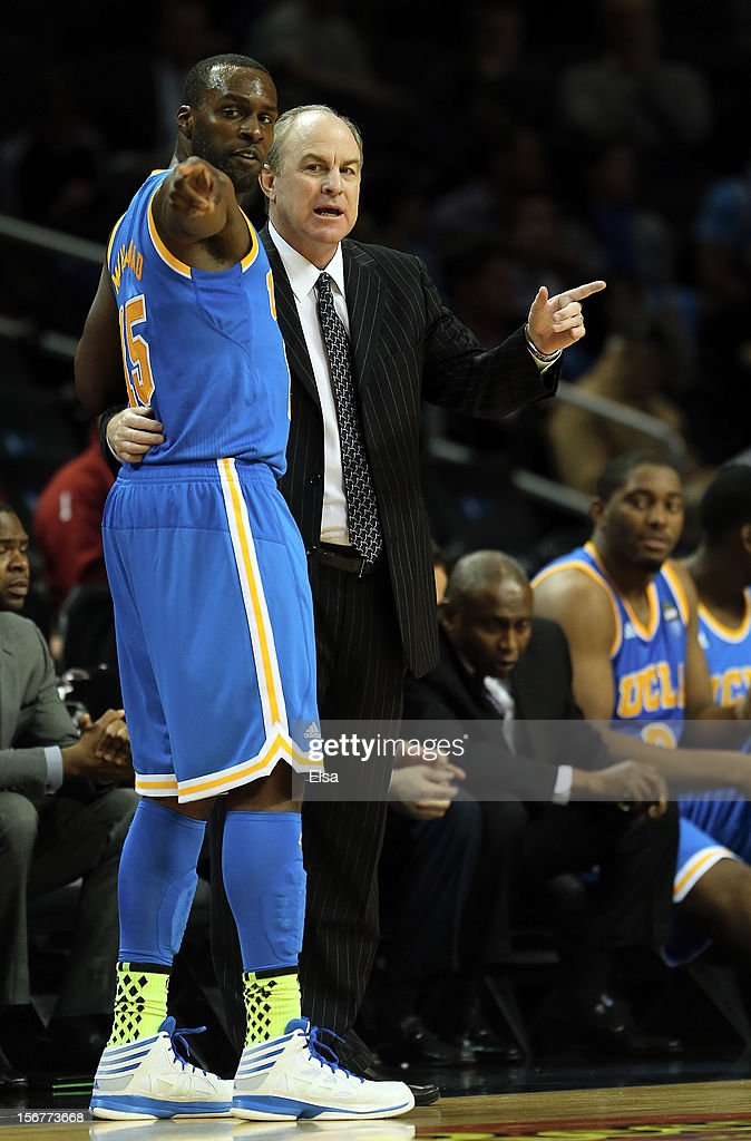 Head coach <a gi-track='captionPersonalityLinkClicked' href=/galleries/search?phrase=Ben+Howland&family=editorial&specificpeople=213373 ng-click='$event.stopPropagation()'>Ben Howland</a> of the UCLA Bruins talks with <a gi-track='captionPersonalityLinkClicked' href=/galleries/search?phrase=Shabazz+Muhammad&family=editorial&specificpeople=7447677 ng-click='$event.stopPropagation()'>Shabazz Muhammad</a> #15 during a time out in the second half against the Georgia Bulldogs during the Legends Classic on November 20,2012 at the Barclays Center in the Brooklyn borough of New York City.