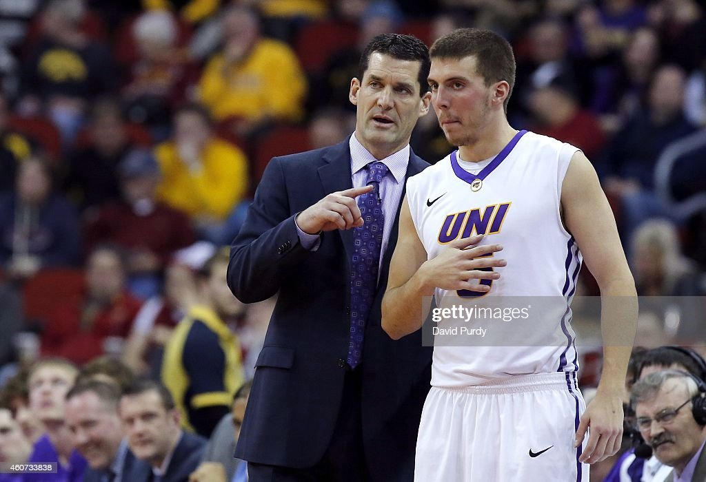 Head coach Ben Jacobson of the Northern Iowa Panthers coaches Matt Bohannon of the Northern Iowa Panthers during a timeout in the second half of play...