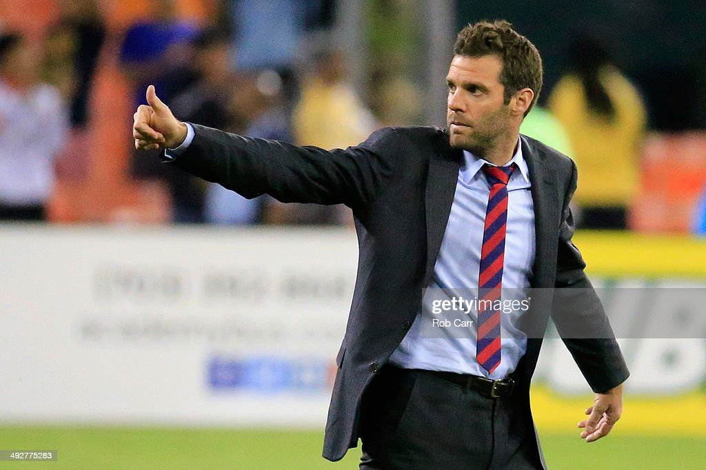 Head coach <a gi-track='captionPersonalityLinkClicked' href=/galleries/search?phrase=Ben+Olsen&family=editorial&specificpeople=733816 ng-click='$event.stopPropagation()'>Ben Olsen</a> of D.C. United gives the thumbs up to the crowd following their 2-0 win over the Houston Dynamo at RFK Stadium on May 21, 2014 in Washington, DC.