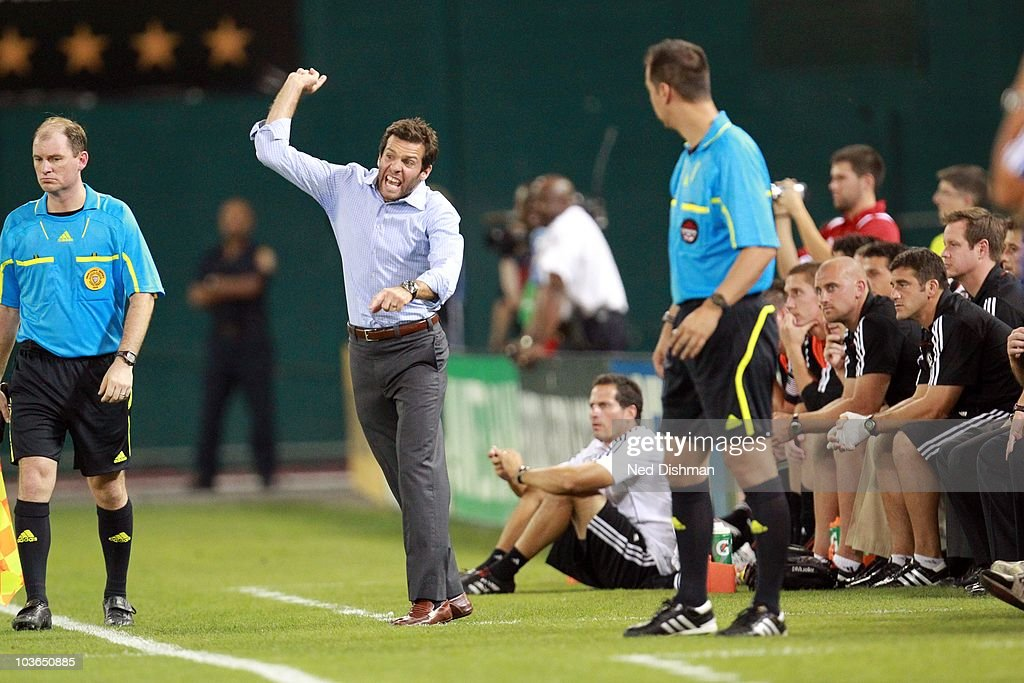 Head coach <a gi-track='captionPersonalityLinkClicked' href=/galleries/search?phrase=Ben+Olsen&family=editorial&specificpeople=733816 ng-click='$event.stopPropagation()'>Ben Olsen</a> of D.C. United reacts on the bench against FC Dallas at RFK Stadium on August 14, 2010 in Washington, DC. FC Dallas won 3-1.