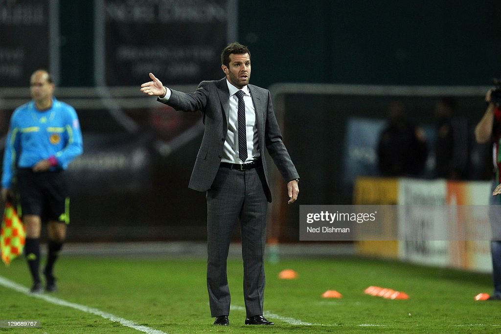 Head coach <a gi-track='captionPersonalityLinkClicked' href=/galleries/search?phrase=Ben+Olsen&family=editorial&specificpeople=733816 ng-click='$event.stopPropagation()'>Ben Olsen</a> of D.C. United reacts on the sideline against the Chicago Fire at RFK Stadium on October 15, 2011 in Washington, DC. The Fire won 2-1.
