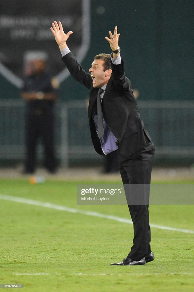 Head coach <a gi-track='captionPersonalityLinkClicked' href=/galleries/search?phrase=Ben+Olsen&family=editorial&specificpeople=733816 ng-click='$event.stopPropagation()'>Ben Olsen</a> of D.C. United reacts to a call during a soccer game against the Toronto FC at RFK Stadium on August 6, 2011 in Washington, DC. The game ended in a 3-3 tie.