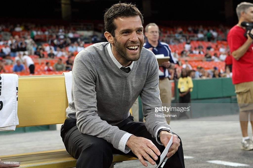 Head coach <a gi-track='captionPersonalityLinkClicked' href=/galleries/search?phrase=Ben+Olsen&family=editorial&specificpeople=733816 ng-click='$event.stopPropagation()'>Ben Olsen</a> of D.C. United smiles on the bench against the Columbus Crew at RFK Stadium on September 4, 2010 in Washington, DC.