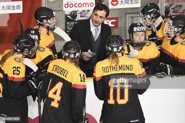 Head coach Benjamin Hinterstocker of Germany speaks to his players during the Women's Ice Hockey Olympic Qualification Final game between Japan and...