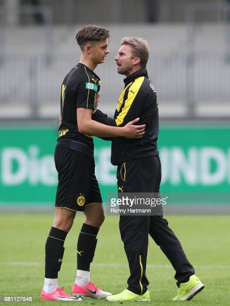Head coach Benjamin Hoffmann of Dortmund argues with Alexander Laukart of Dortmund during the AJuniors German Championship semi final first leg match...
