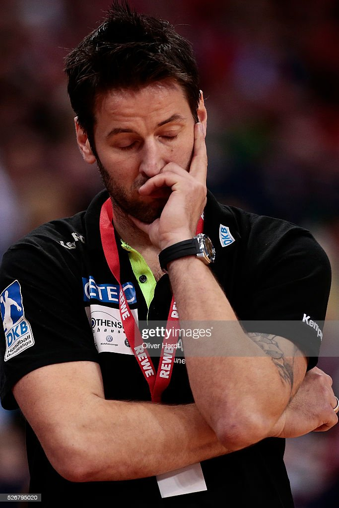 Head coach <a gi-track='captionPersonalityLinkClicked' href=/galleries/search?phrase=Bennet+Wiegert&family=editorial&specificpeople=709927 ng-click='$event.stopPropagation()'>Bennet Wiegert</a> of Magdeburg appears frustrated during the DKB REWE Final Four Finale 2016 between SG Flensburg Handewitt and SC Magdeburg at Barclaycard Arena on May 1, 2016 in Hamburg, Germany.