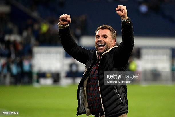 Head coach Bernd Hollerbach of Wuerzburg celebrates after winning the 2 Bundesliga playoff leg 2 match against MSV Duisburg at...