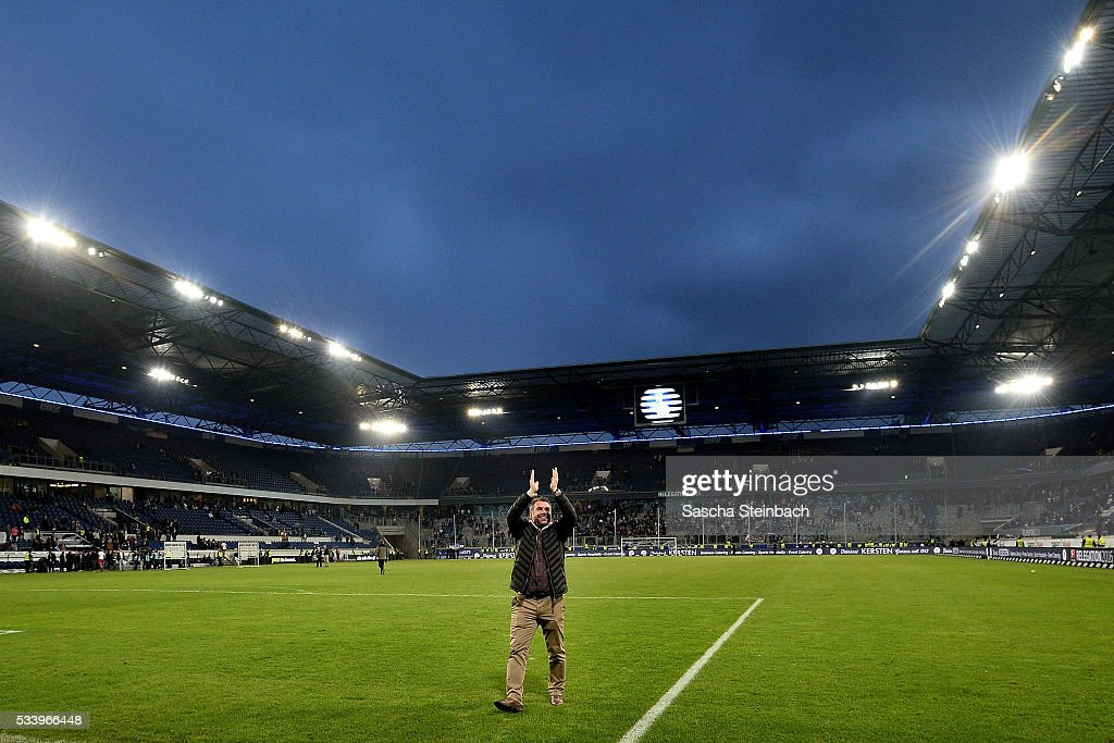 Head coach <a gi-track='captionPersonalityLinkClicked' href=/galleries/search?phrase=Bernd+Hollerbach&family=editorial&specificpeople=2057054 ng-click='$event.stopPropagation()'>Bernd Hollerbach</a> of Wuerzburg celebrates after winning the 2. Bundesliga playoff leg 2 match against MSV Duisburg at Schauinsland-Reisen-Arena on May 24, 2016 in Duisburg, Germany.
