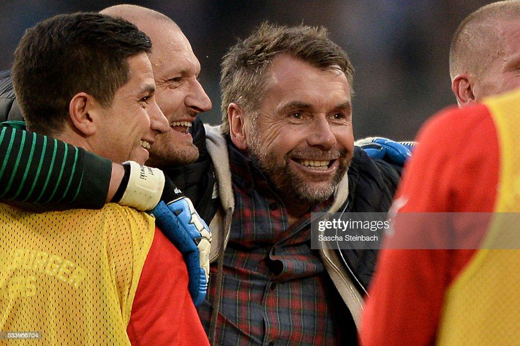 Head coach Bernd Hollerbach (R) of Wuerzburg celebrates after winning the 2. Bundesliga playoff leg 2 match against MSV Duisburg at Schauinsland-Reisen-Arena on May 24, 2016 in Duisburg, Germany.