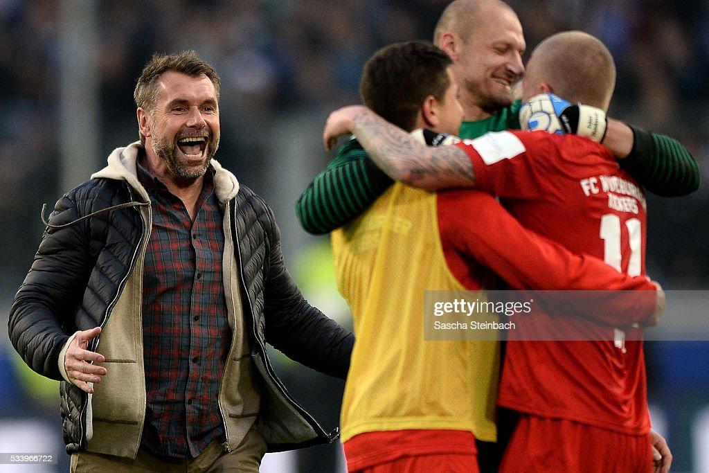 Head coach Bernd Hollerbach (L) of Wuerzburg celebrates after winning the 2. Bundesliga playoff leg 2 match against MSV Duisburg at Schauinsland-Reisen-Arena on May 24, 2016 in Duisburg, Germany.