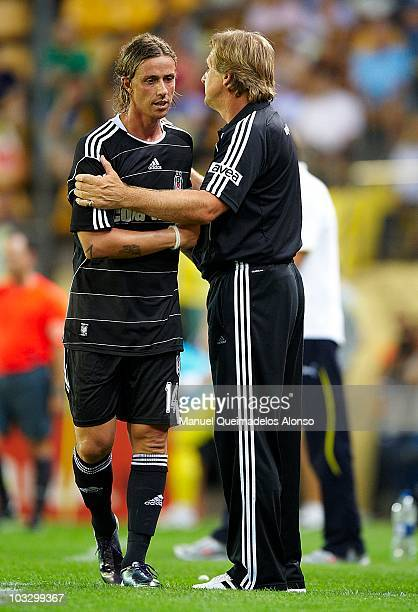 Head coach Bernd Schuster of Besiktas embraces Guti during the Ceramics Trophy match between Villarreal CF and Besiktas at El Madrigal stadium on...