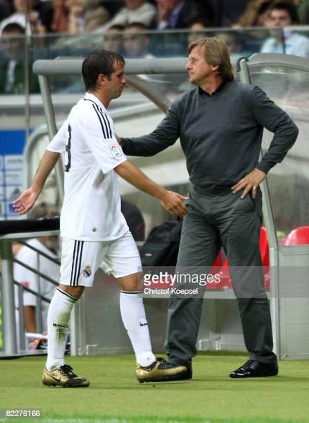 Head coach Bernd Schuster of Real substitutes Rafael van der Vaart during the pre season friendly match between Eintracht Frankfurt and Real Madrid...