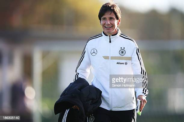 Head coach Bettina Wiegmann of Germany smiles prior to the Girls U15 international friendly match between Germany and Scotland on October 30 2013 in...