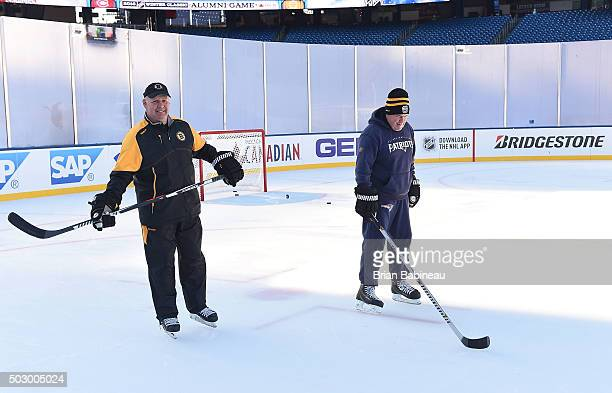Head Coach Bill Belichick of the New England Patriots and head coach Claude Julien of the Boston Bruins skate prior to team practices prior to the...