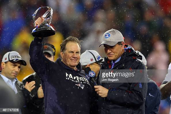 Head coach Bill Belichick of the New England Patriots holds up the Lamar Hunt Trophy after defeating the Indianapolis Colts in the 2015 AFC...