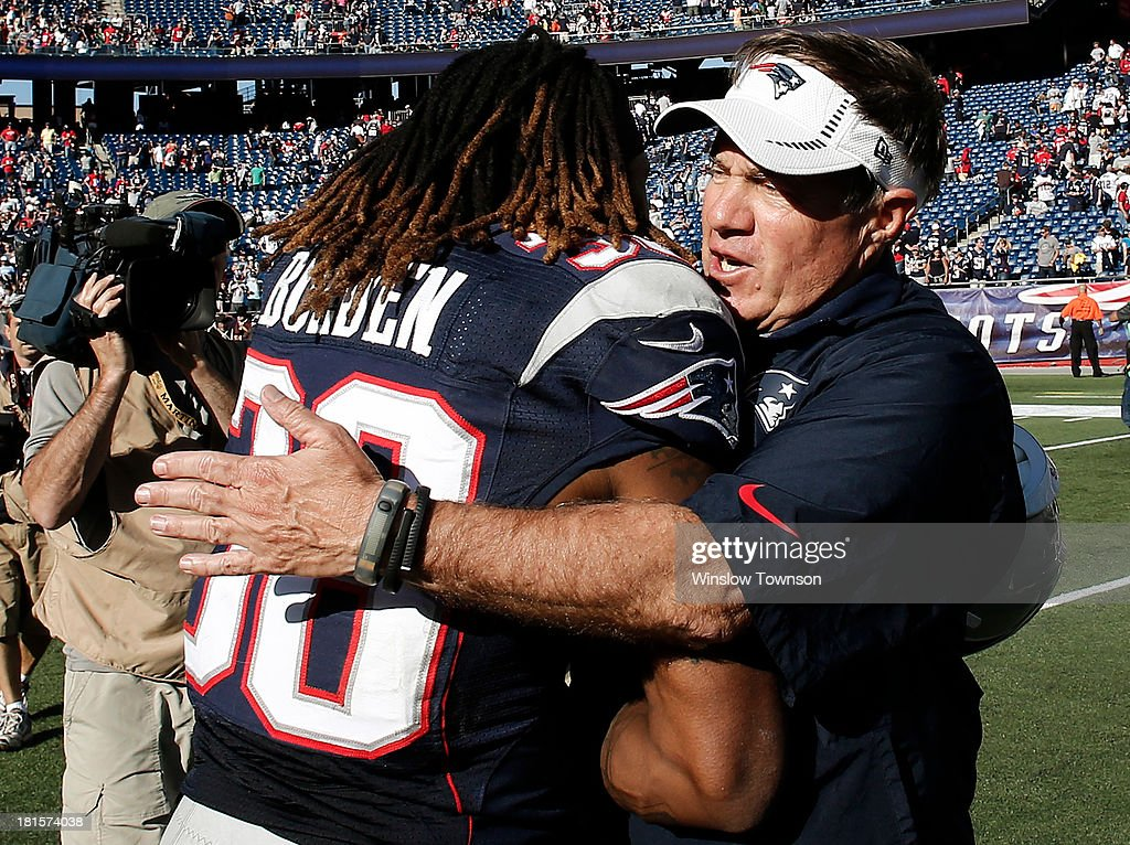 Head coach <a gi-track='captionPersonalityLinkClicked' href=/galleries/search?phrase=Bill+Belichick&family=editorial&specificpeople=201822 ng-click='$event.stopPropagation()'>Bill Belichick</a> of the New England Patriots hugs <a gi-track='captionPersonalityLinkClicked' href=/galleries/search?phrase=Brandon+Bolden&family=editorial&specificpeople=5539530 ng-click='$event.stopPropagation()'>Brandon Bolden</a> #38 of the New England Patriots after their 23-3 win over the Tampa Bay Buccaneers at Gillette Stadium on September 22, 2013 in Foxboro, Massachusetts.
