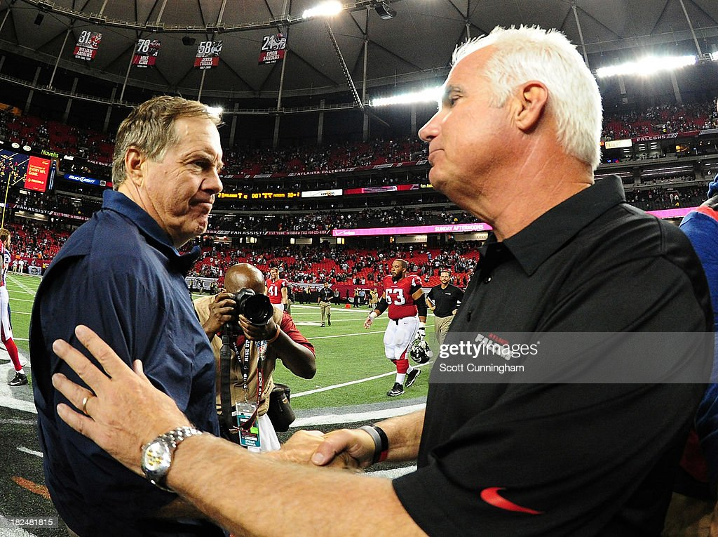 Head Coach <a gi-track='captionPersonalityLinkClicked' href=/galleries/search?phrase=Bill+Belichick&family=editorial&specificpeople=201822 ng-click='$event.stopPropagation()'>Bill Belichick</a> (L) of the New England Patriots is congratulated by Head Coach Mike Smith of the Atlanta Falcons at the Georgia Dome on September 29, 2013 in Atlanta, Georgia.