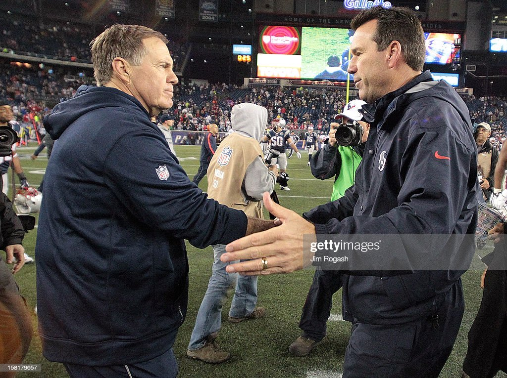 Head coach <a gi-track='captionPersonalityLinkClicked' href=/galleries/search?phrase=Bill+Belichick&family=editorial&specificpeople=201822 ng-click='$event.stopPropagation()'>Bill Belichick</a> of the New England Patriots shakes hands with Head coach <a gi-track='captionPersonalityLinkClicked' href=/galleries/search?phrase=Gary+Kubiak&family=editorial&specificpeople=614731 ng-click='$event.stopPropagation()'>Gary Kubiak</a> of the Houston Texans after Patriot win at Gillette Stadium on December 10, 2012 in Foxboro, Massachusetts.