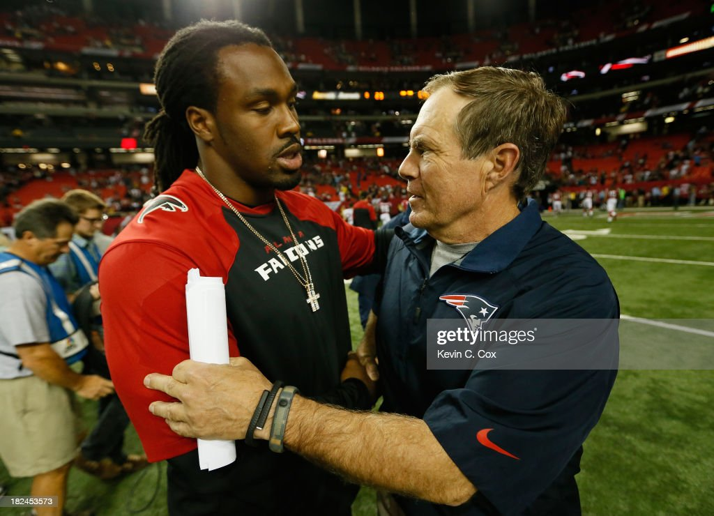 Head coach Bill Belichick of the New England Patriots shakes hands with Steven Jackson of the Atlanta Falcons after their 3023 win at Georgia Dome on...