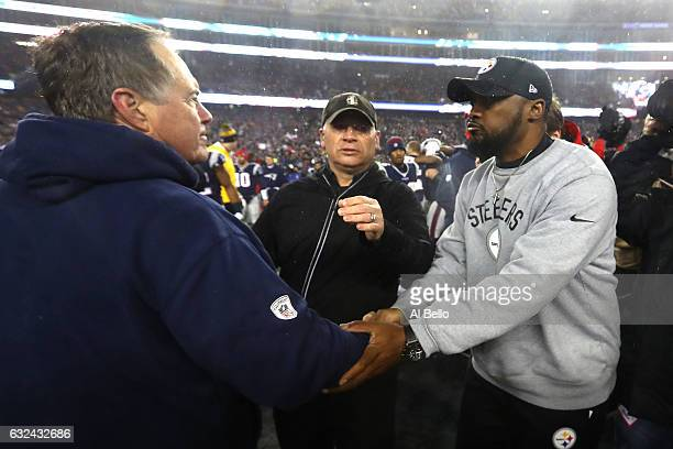 Head coach Bill Belichick of the New England Patriots shakes hands with head coach Mike Tomlin of the Pittsburgh Steelers after the Patriots defeated...