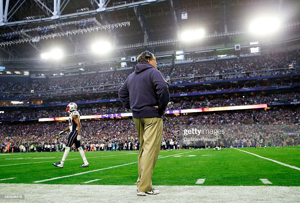 Head coach Bill Belichick of the New England Patriots watches from the sidelines as his team plays the Seattle Seahawks in the second quarter during...