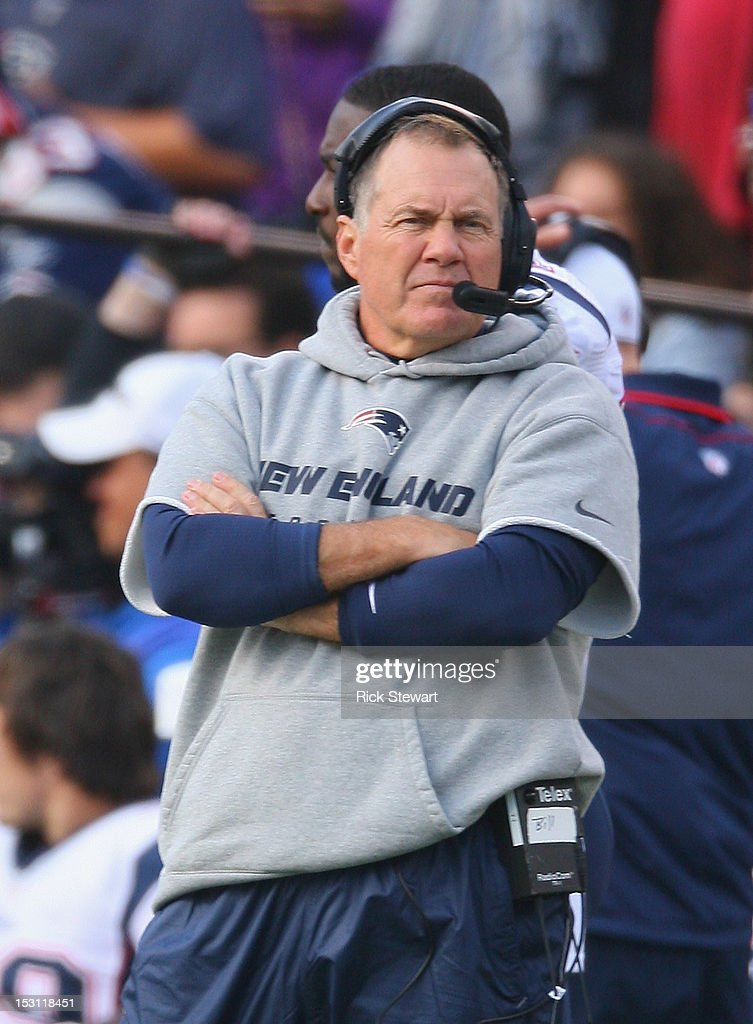 Head coach <a gi-track='captionPersonalityLinkClicked' href=/galleries/search?phrase=Bill+Belichick&family=editorial&specificpeople=201822 ng-click='$event.stopPropagation()'>Bill Belichick</a> of the New England Patriots watches play against the Buffalo Bills at Ralph Wilson Stadium on September 30, 2012 in Orchard Park, New York.New England won 52-28.