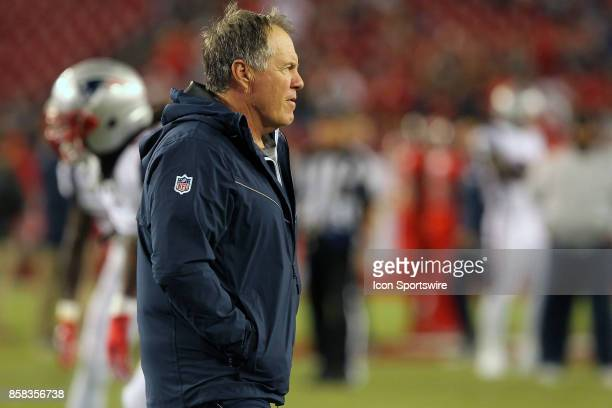 Head Coach Bill Belichick of the Patriots watches his team warm up before the NFL Regular game between the New England Patriots and the Tampa Bay...