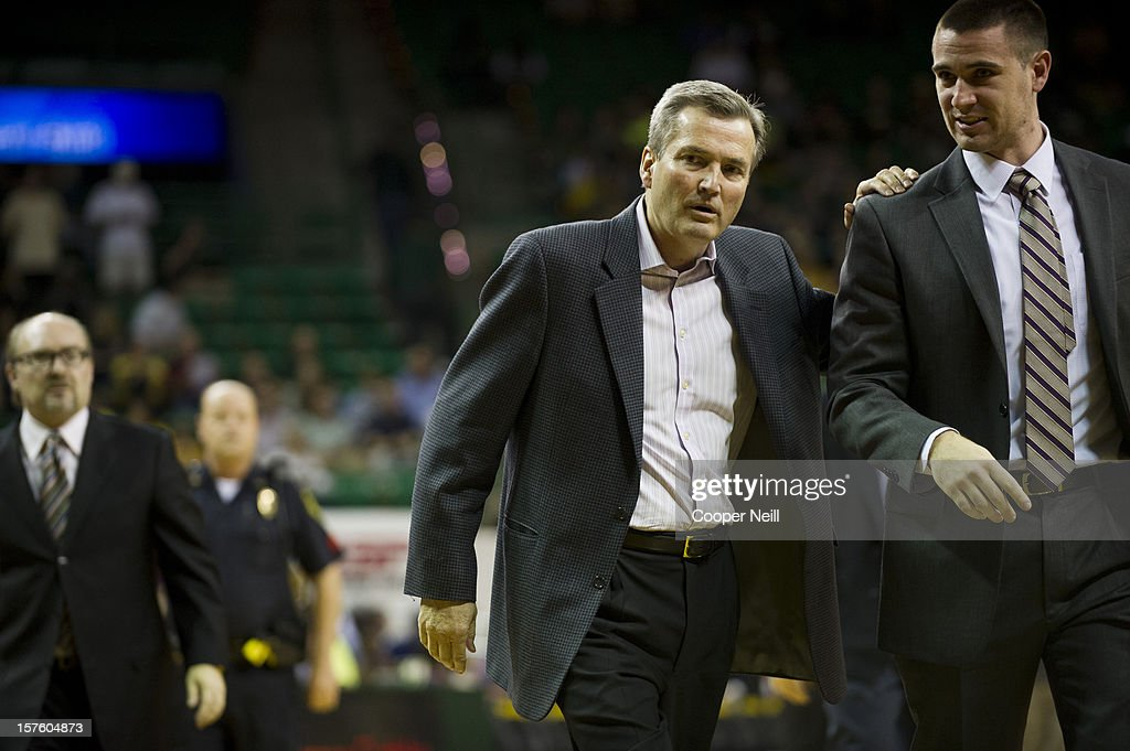 Head coach Bill Carmody of the Northwestern University Wildcats has words with an assistant as he exits the court at half time against the Baylor University Bears on December 4, 2012 at the Ferrell Center in Waco, Texas.