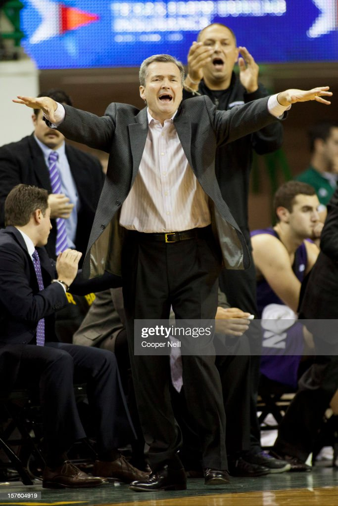 Head coach Bill Carmody of the Northwestern University Wildcats yells at his players against the Baylor University Bears on December 4, 2012 at the Ferrell Center in Waco, Texas.