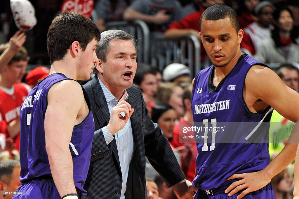 Head coach Bill Carmody of the Northwestern Wildcats gives instructions to Dave Sobolweski #3 and Reggie Hearn #11 in the second half against the Ohio State Buckeyes on February 14, 2013 at Value City Arena in Columbus, Ohio. Ohio State defeated Northwestern 69-59.