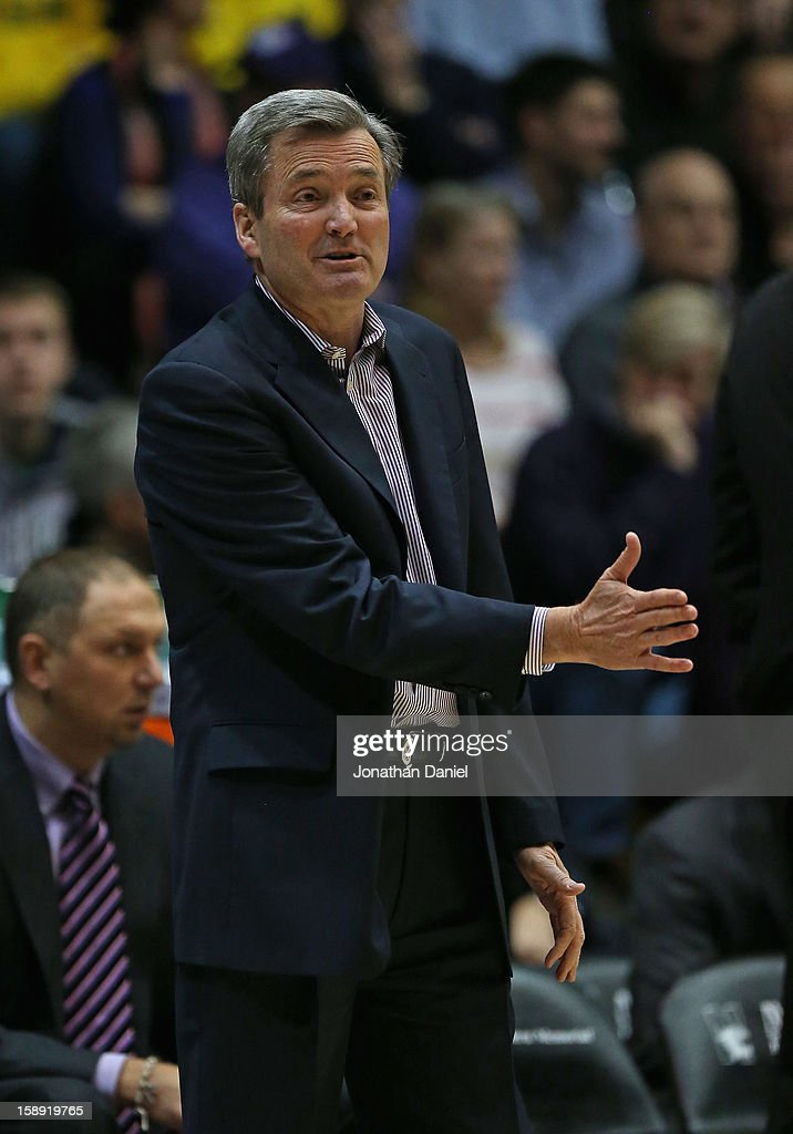 Head coach Bill Carmody of the Northwestern Wildcats gives instructions to his team against the Michigan Wolverines at Welsh-Ryan Arena on January 3, 2013 in Evanston, Illinois. Michigan defeated Northwestern 94-66.