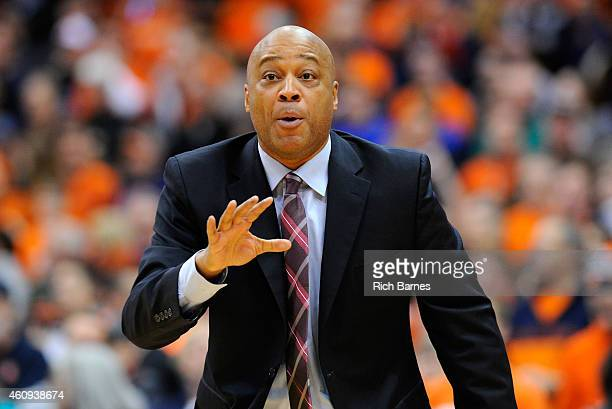 Head coach Bill Courtney of the Cornell Big Red reacts to a play against the Syracuse Orange during the first half at the Carrier Dome on December 31...