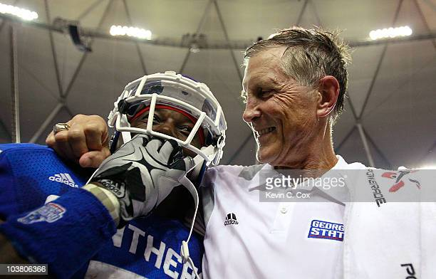 Head coach Bill Curry of the Georgia State Panthers celebrates their 417 win over the Shorter Hawks with Parris Lee at Georgia Dome on September 2...