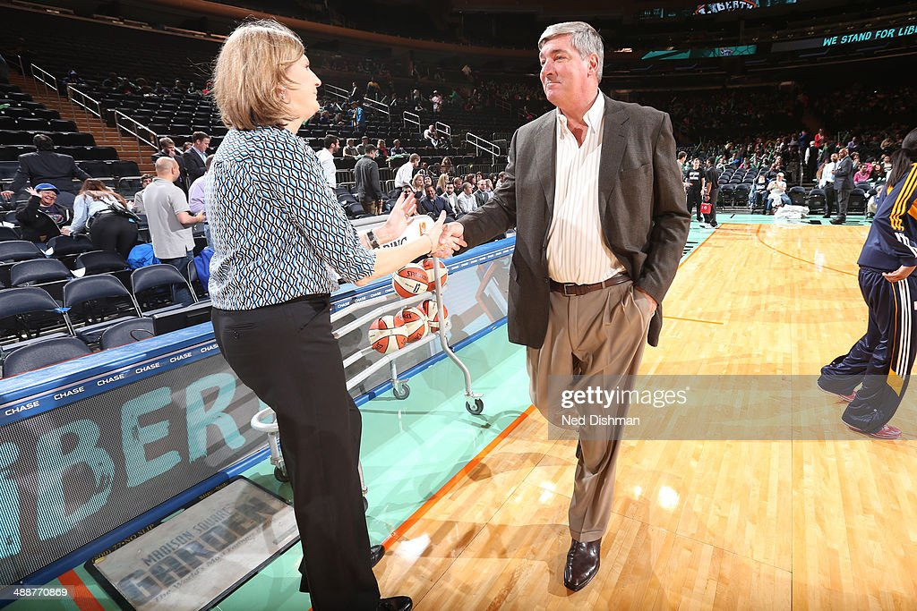 Head coach Bill Laimbeer of the New York Liberty shakes hands with head coach Anne Donovan of the Connecticut Sun before the game at Madison Square...