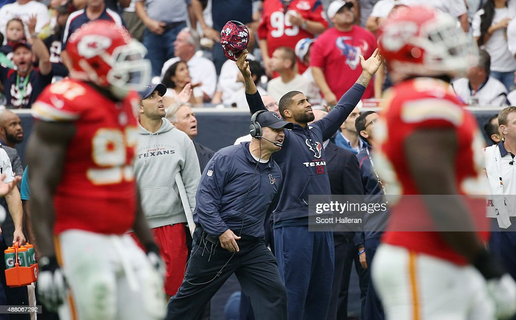 Head coach Bill O'Brien and Arian Foster of the Houston Texans react to a call in the first half of their game against the Kansas City Chiefs at NRG...