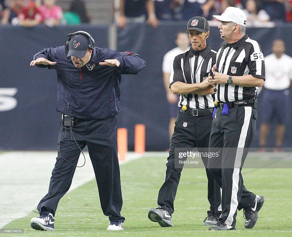 Head coach <a gi-track='captionPersonalityLinkClicked' href=/galleries/search?phrase=Bill+O%27Brien+-+Coach&family=editorial&specificpeople=9756725 ng-click='$event.stopPropagation()'>Bill O'Brien</a> of the Houston Texans argues a call with referee <a gi-track='captionPersonalityLinkClicked' href=/galleries/search?phrase=Bill+Vinovich&family=editorial&specificpeople=2111393 ng-click='$event.stopPropagation()'>Bill Vinovich</a> #52 in the first quarter against the Buffalo Bills in a NFL game on September 28, 2014 at NRG Stadium in Houston, Texas.