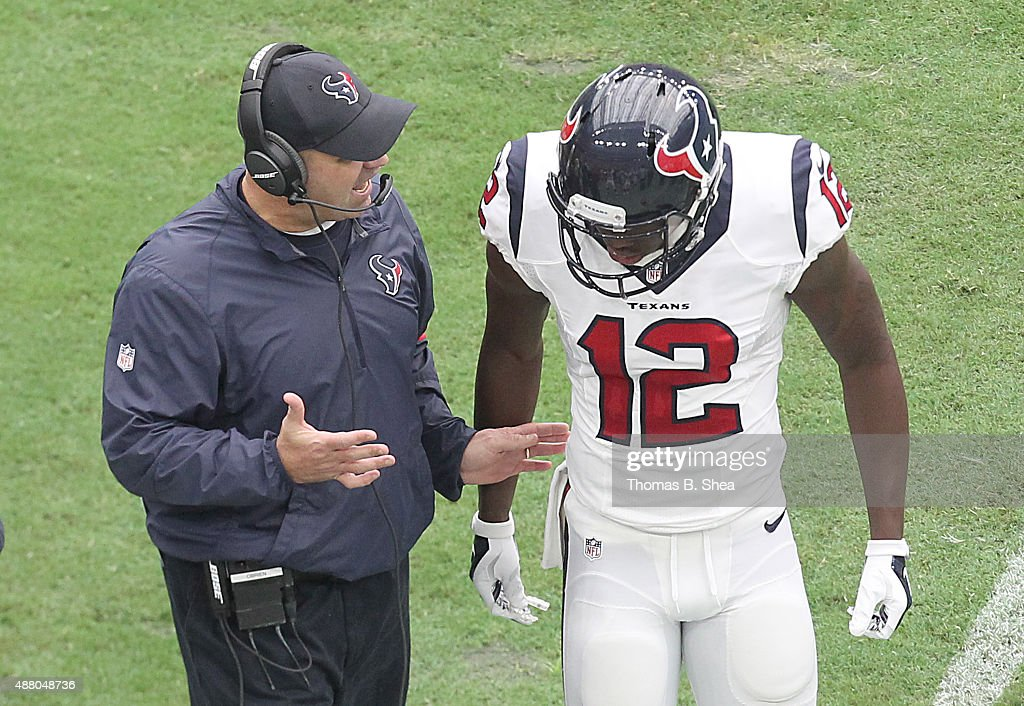 Head coach Bill O'Brien of the Houston Texans talk to Keith Mumphery of the Houston Texans on the sidelines while playing against the Kansas City...