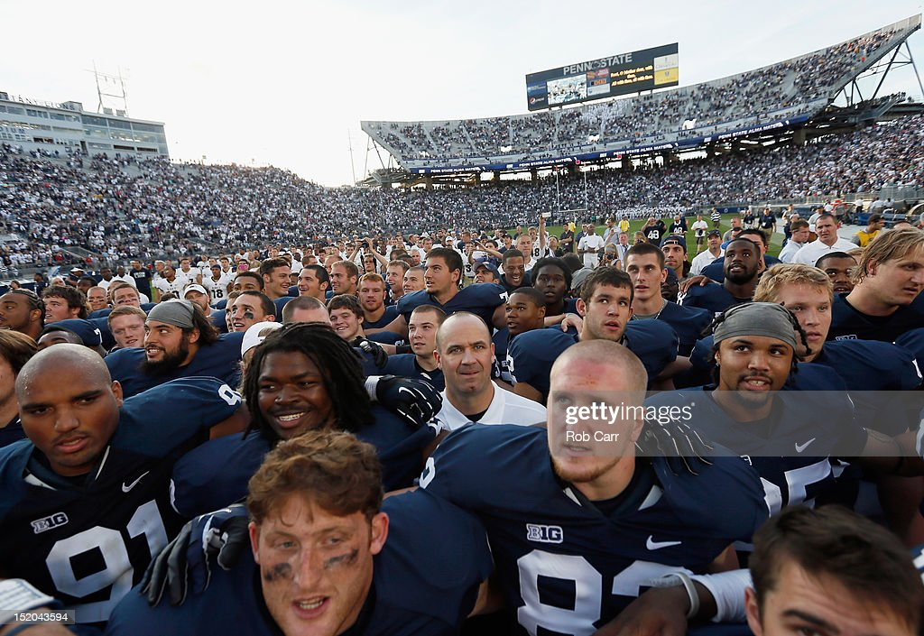 Head coach Bill O'Brien of the Penn State Nittany Lions sings the schools fight song with the team after defeating the Navy Midshipmen 347 at Beaver...