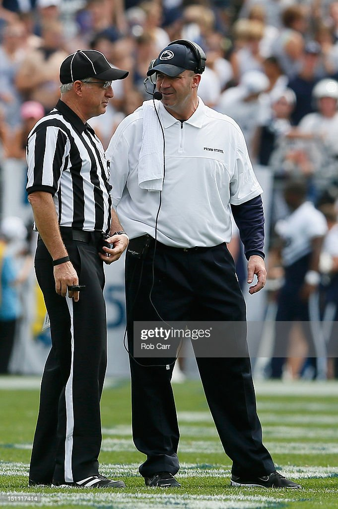 Head coach Bill O'Brien of the Penn State Nittany Lions talks with an official during the first half of their game against the Ohio Bobcats at Beaver Stadium on September 1, 2012 in State College, Pennsylvania.