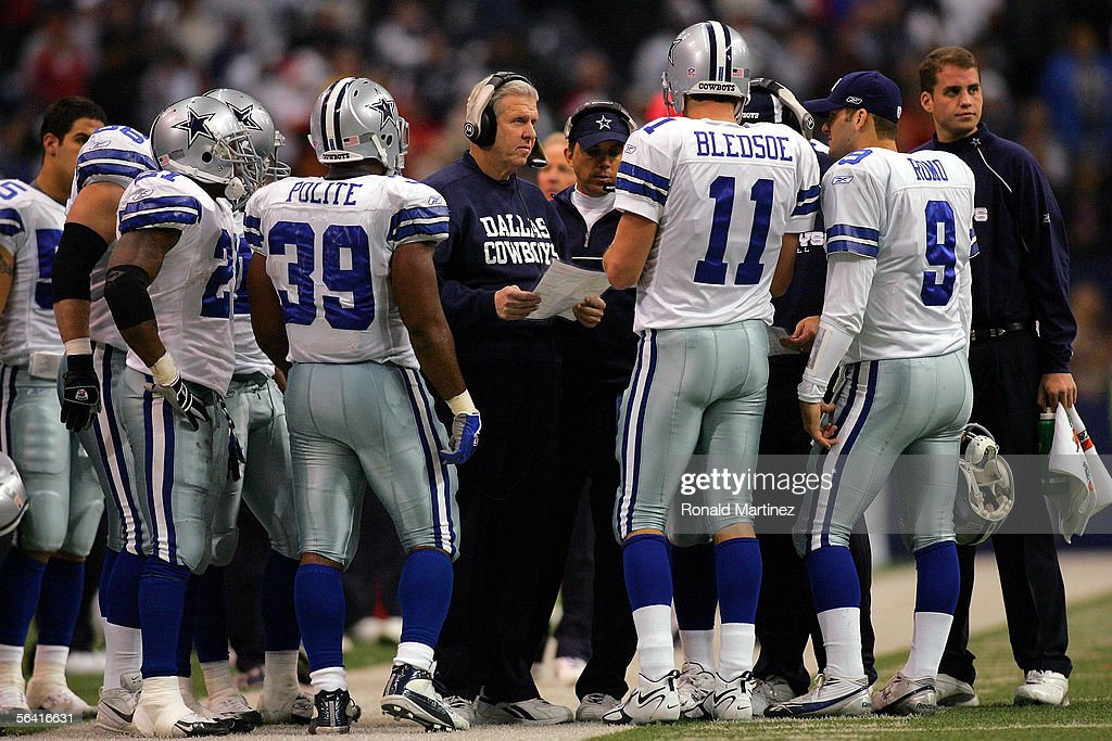 Head coach Bill Parcells of the Dallas Cowboys talks with his quarterback Drew Bledsoe #11 during their game against the Kansas City Chiefs on December 11, 2005 at Texas Stadium in Irving, Texas. The Cowboys defeated the Chiefs 31-28.